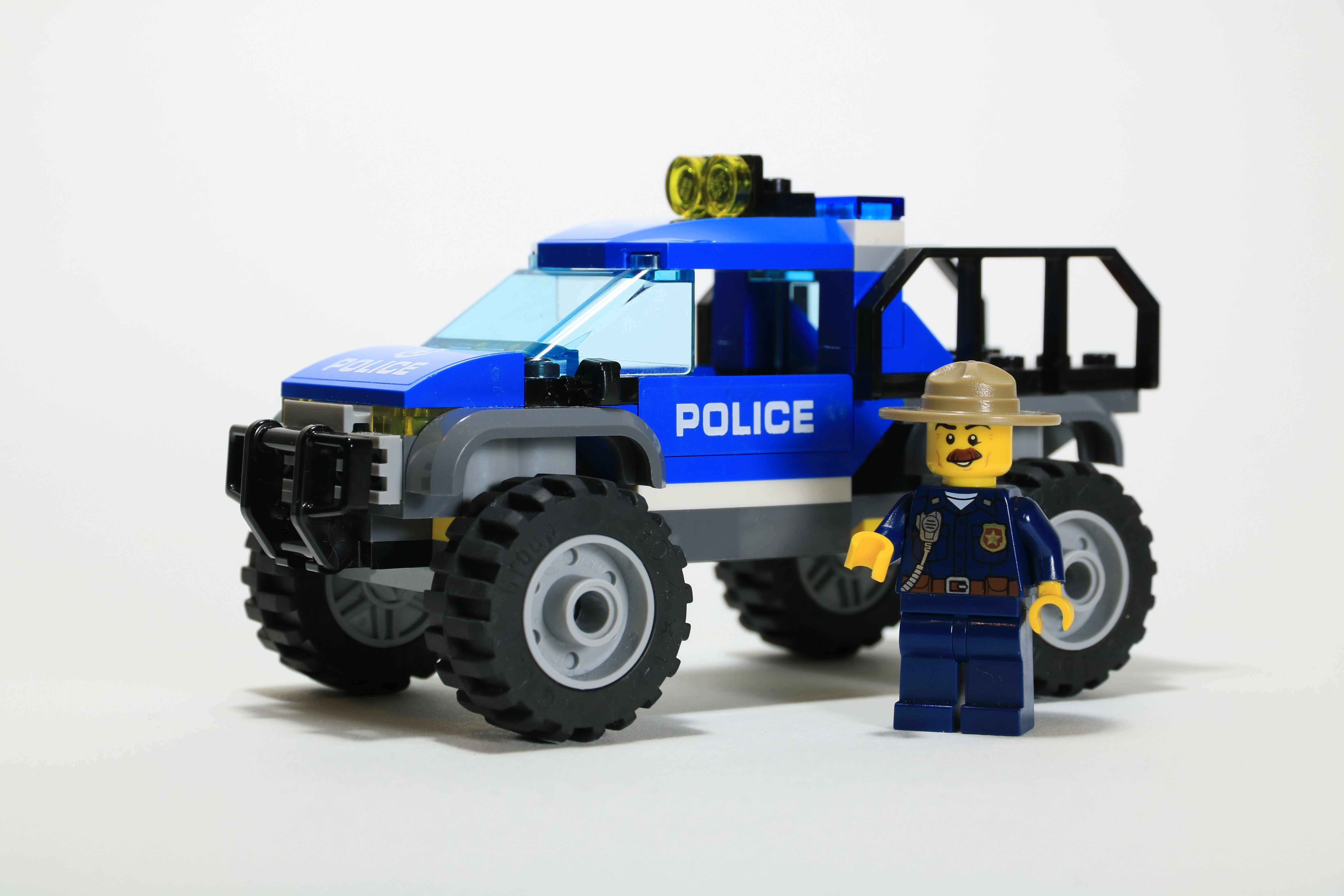 LEGO Police chief standing beside his truck.